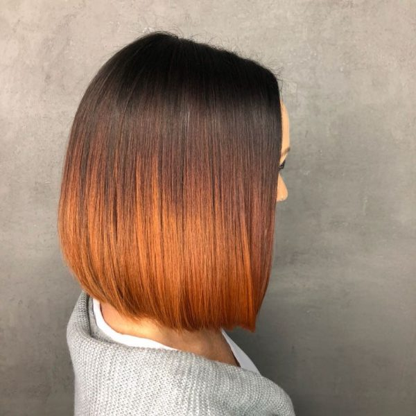 Hair by Mahogany custom bob unit with dark brown roots to orange.