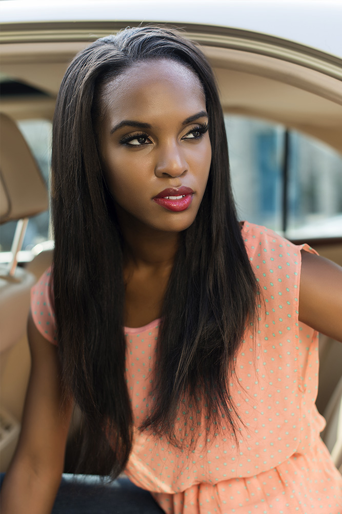 Beautiful African-American model with Hair By Mahogany luxury 100% virgin hair in straight texture.